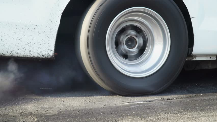 Drag Racing Car Burns Rubber Off Its Tires In Preparation For The