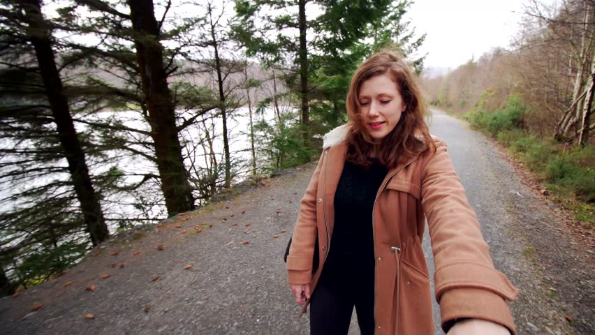 Point of view POV couple walking woods, overcast United Kingdom. Beautiful girl exploring nature date. Ginger brown hair White Caucasian attractive female smiling. First person viewpoint perspective | Shutterstock HD Video #25410287