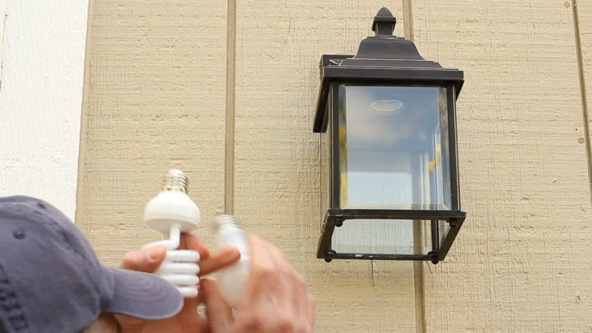 Man Outside Changing An Incandescent Light Bulb To A CFL Light Bulb In An Outdoor  Light Fixture To Save Energy. Stock Footage Video 2542277 | Shutterstock Part 89