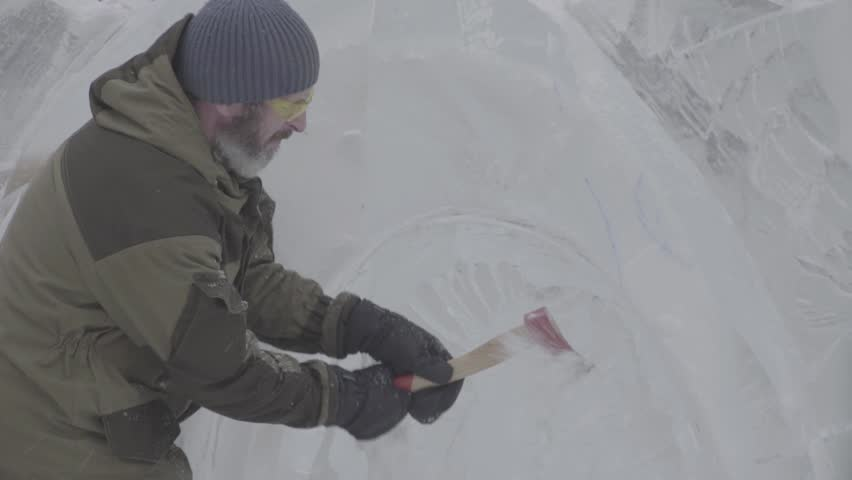 Master Scraper Performs A Movement Across The Ice To Create An Ice Sculpture. Master using Special Tool To Grind Down Form Ice Pieces. Ice Compositions Performs Notches And Grooves In The Piece Of | Shutterstock HD Video #25422977