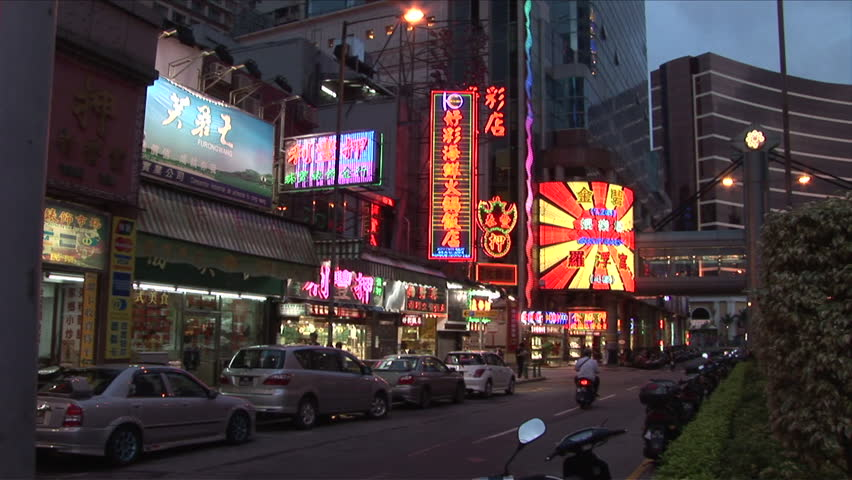 Macau, China - CIRCA March, 2007: Many intense neon signs of all sizes lights up a quiet street at night