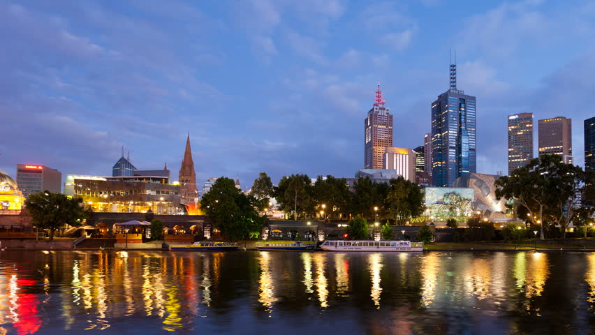 MELBOURNE - JAN 10: Timelapse view of the Melbourne city skyline at Dawn on January 10, 2012 in Melbourne, Australia.