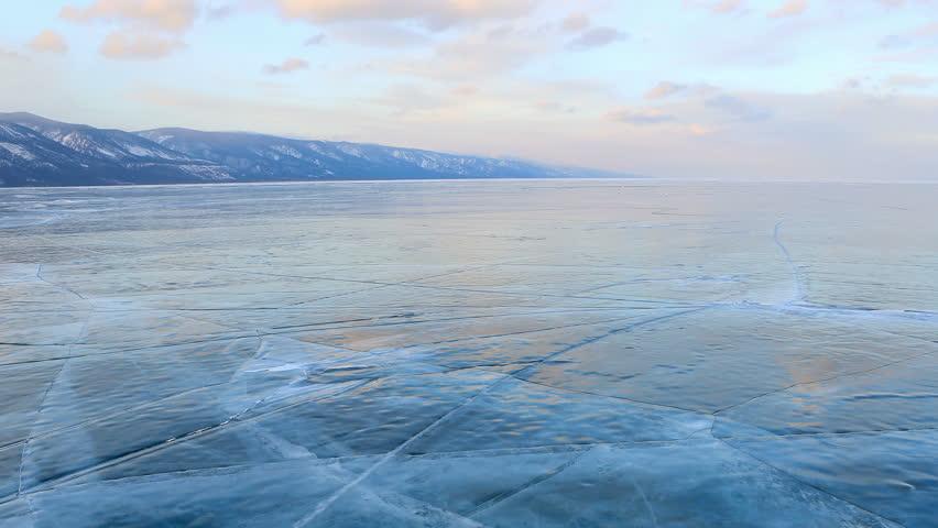 4K. Sunset in the icy Lake Baikal, Irkutsk region, Russia. Ultra HD, 4096x2304