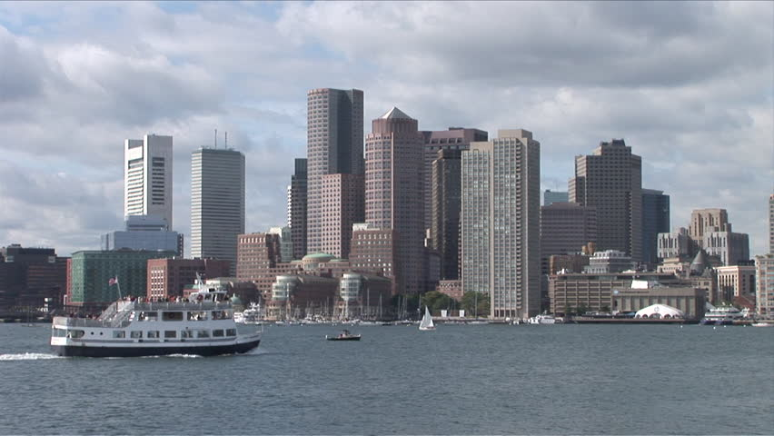 Wide view of the skyline of Boston sitting on the bay seen during the day