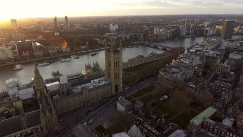 Aerial View Flying Over Big Ben in London feat British Flag and Sunshine 4K