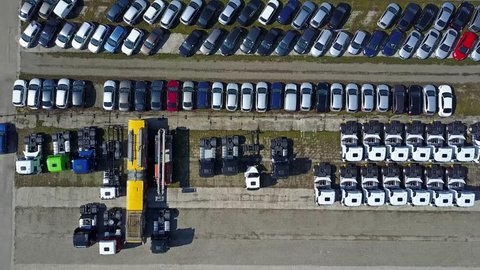 Aerial shot of cars and trucks storage, top view. 4K video