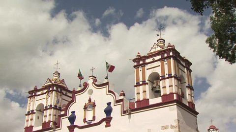 Up View of A Catholic Church In Mexico with a Cloudy Sky in the Background