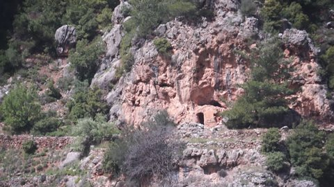 Hermitage, Monastery of Mar Sarkis, Qadisha Valley. Tilt-down to the ruins of a medieval hermitage built into a cave in the cliffside.