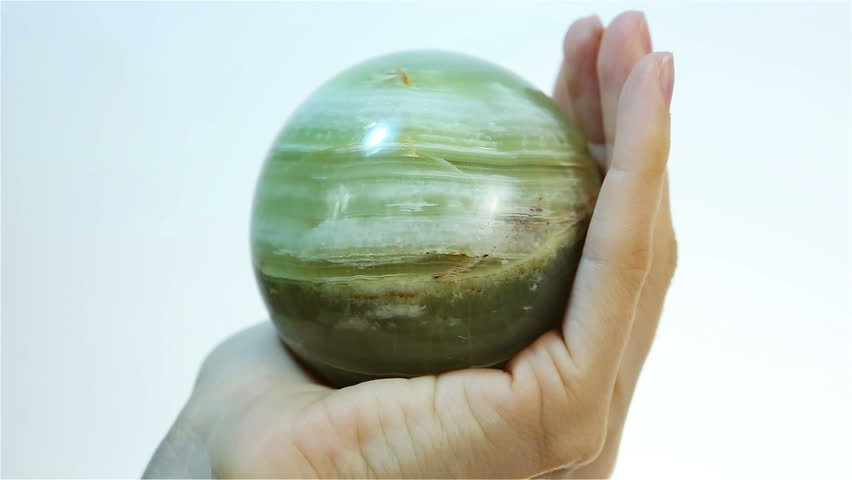 Marble Onyx orb - magical ball onyx marble. This exotic natural Healing stone. Hand holding Marble Onyx. Semiprecious gem for jewels, esoteric and alternative medicine.