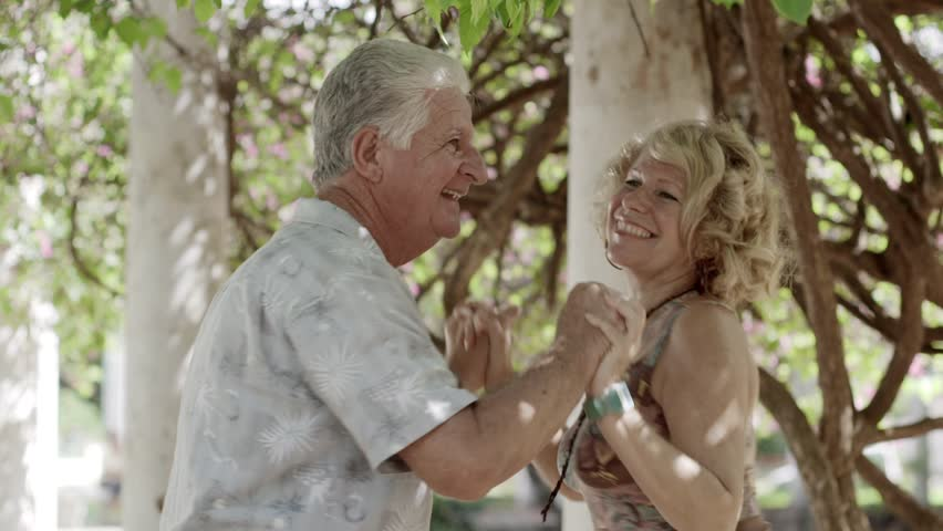 Active retirement and leisure activities, happy old people dancing latin american dance on holidays | Shutterstock HD Video #2568101