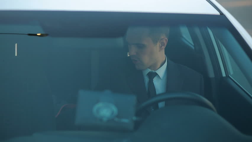 Businessman in the car, looking around, watching what is happening | Shutterstock HD Video #25697747