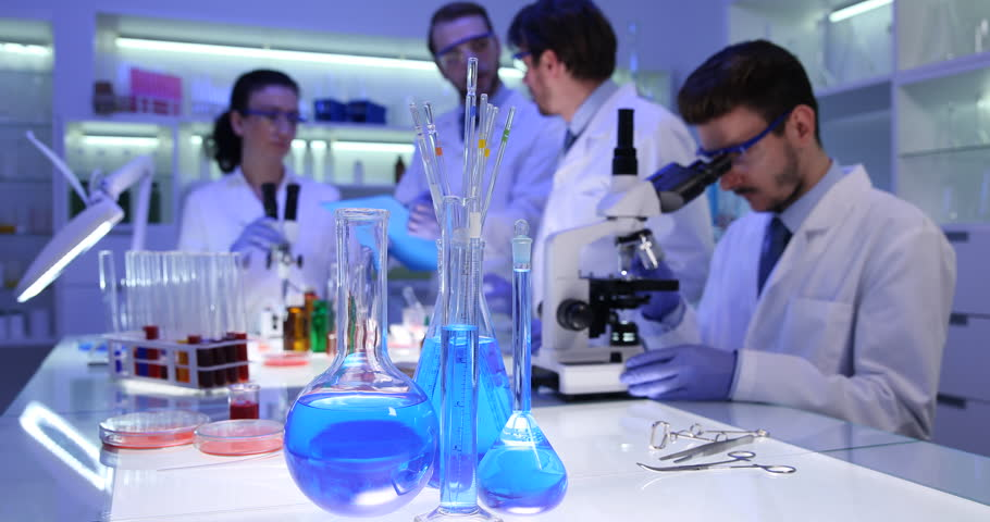 Forensics Science Team of Researchers Working in Laboratory on Medical Research