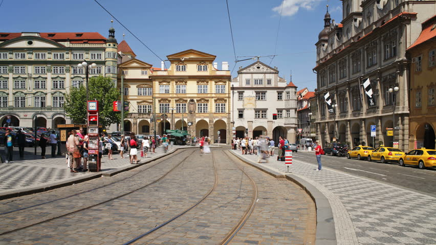 PRAGUE, CZECH REPUBLIC - CIRCA MAY 2011: Prague City centre with its famous Red Trams and many Pedestrians