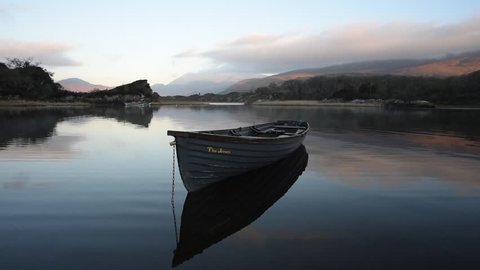 Killarney National Park in Kerry, Ireland / Lake boat/  Morning at Killarney lake with moutains in background, Ireland