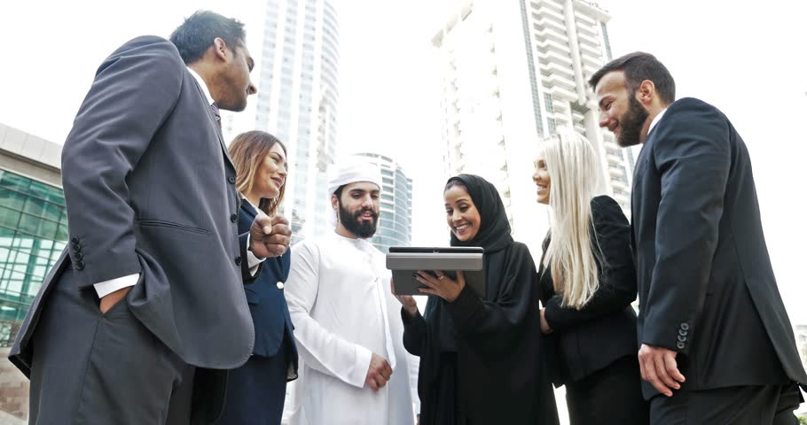 Arabian and western business people talking about business