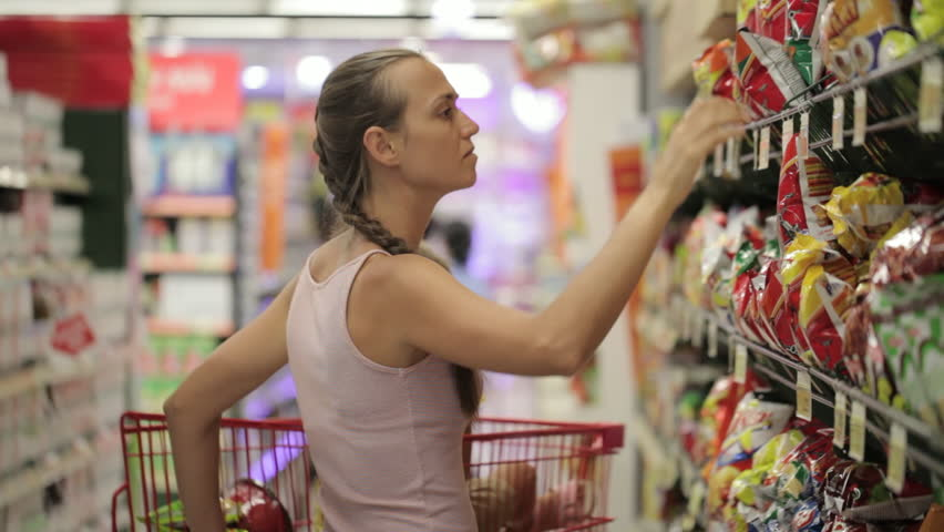 Young mother with little daughter selecting snacks in the sweets section at the supermarket | Shutterstock HD Video #25735307