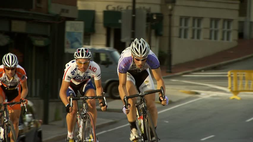 PROVIDENCE, RHODE ISLAND - SEPTEMBER 3, 2009: Tight shot of bicycle racers passing camera - slow motion