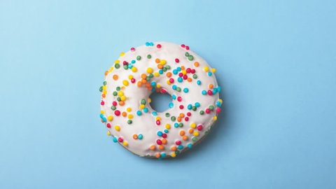eating tasty donuts, time-lapse on blue background