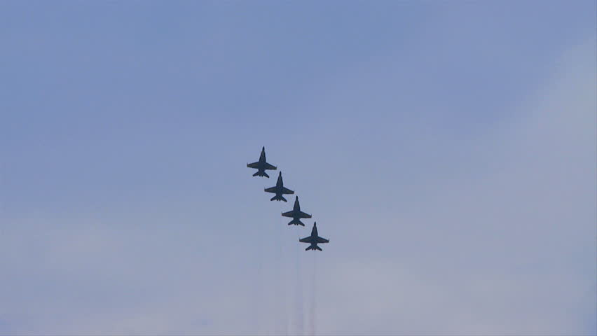 QUONSET, RHODE ISLAND - CIRCA JUNE 2012: Blue Angels - 9 four jets flying straight up