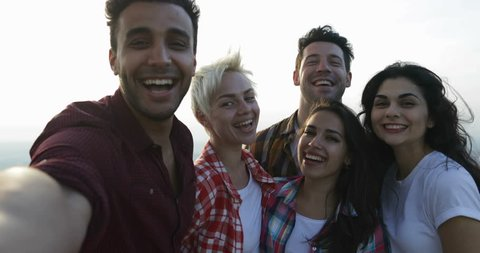 People Take Selfie Photo On Mountain Top At Sunrise, Mix Race Friends Group Tourists Happy Smiling Together Slow Motion 60