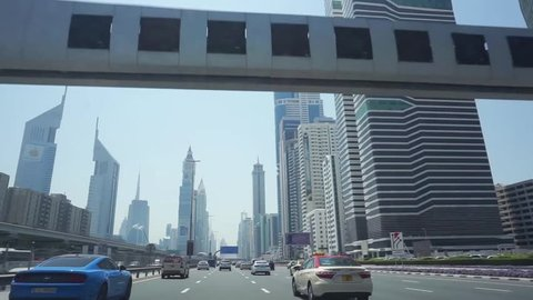 DUBAI, UAE - 01 APRIL 2017 :  Driving on SHEIKH ZAYED ROAD, A high number of tall towers on both side is very impressive. Apart from that Dubai Water Canal is set and officially open now.