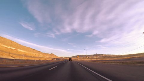 Denver, Colorado, USA-March 318, 2017. POV point of view - Driving 470 highway early in the morning.