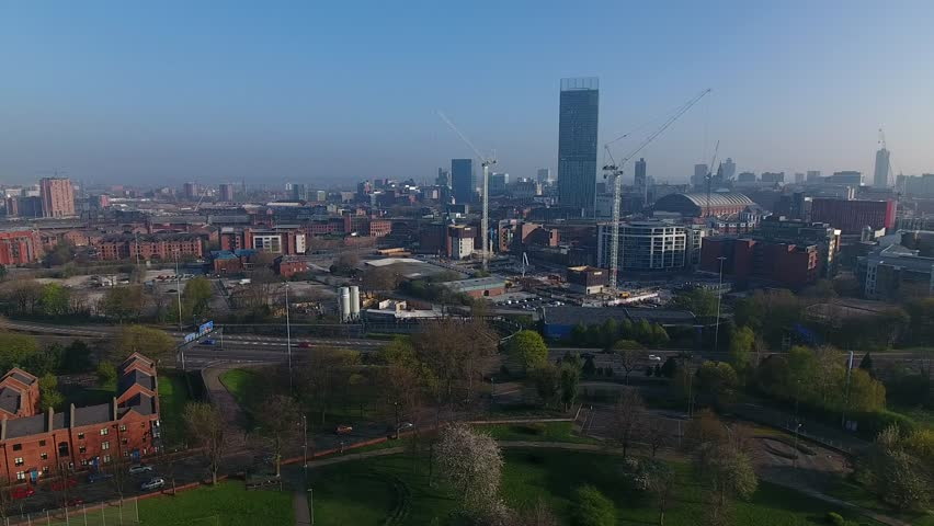 Slow drifting aerial view of Manchester city centre, UK.