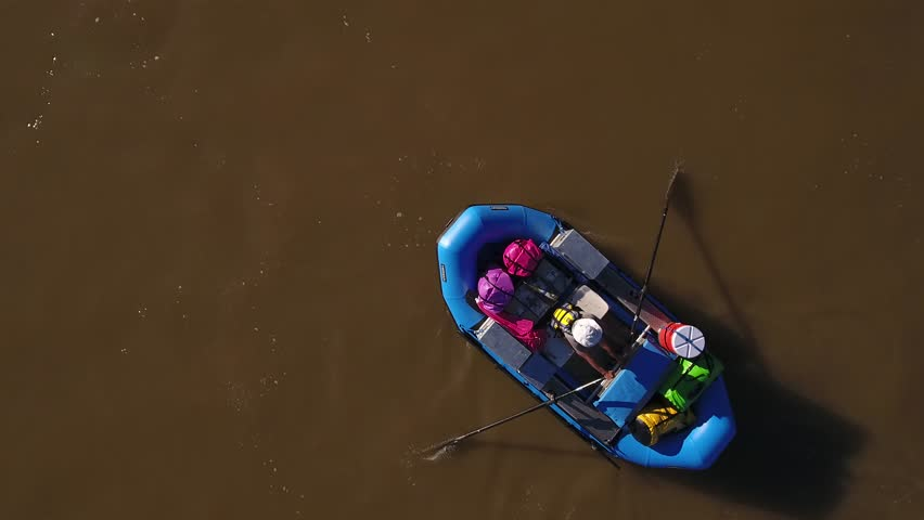 An aerial shot of a family rowing their raft and kayaks down the beautiful colorado river in the desert of Southern Utah | Shutterstock HD Video #25790867