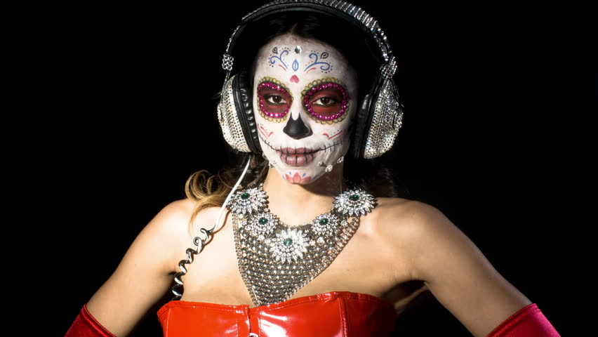 Beautiful woman with custom designed candy skull mexican day of the dead face make up   Shutterstock HD Video #25804589