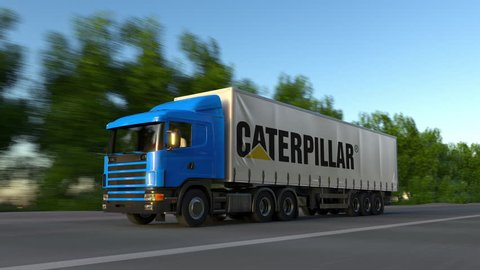 Freight semi truck with Caterpillar Inc. logo driving along forest road, seamless loop. Editorial 4K clip