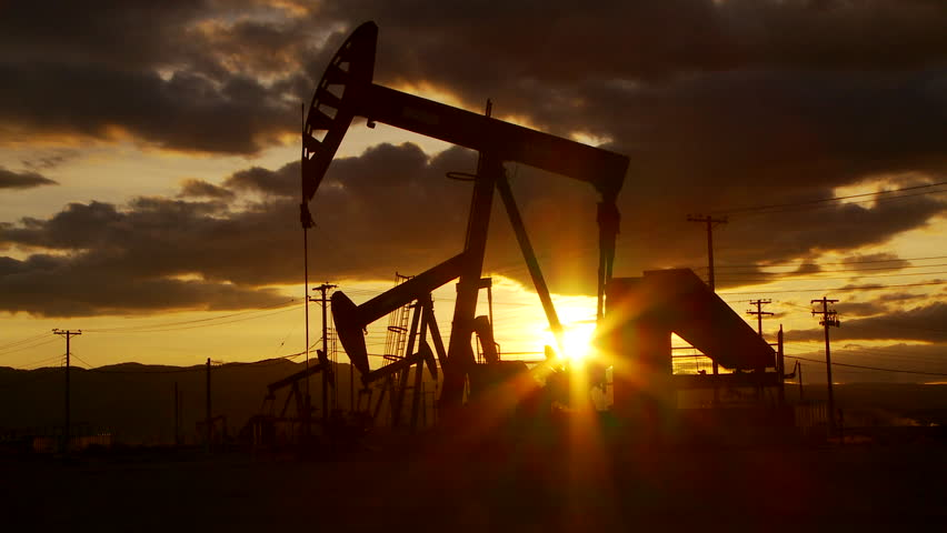 Oil well piston pumps at sunset
