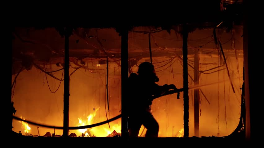 Fire extinguishing, fire brigade inside burning premises. Brave firemen inside burning building. House destroyed by fire | Shutterstock HD Video #25862027