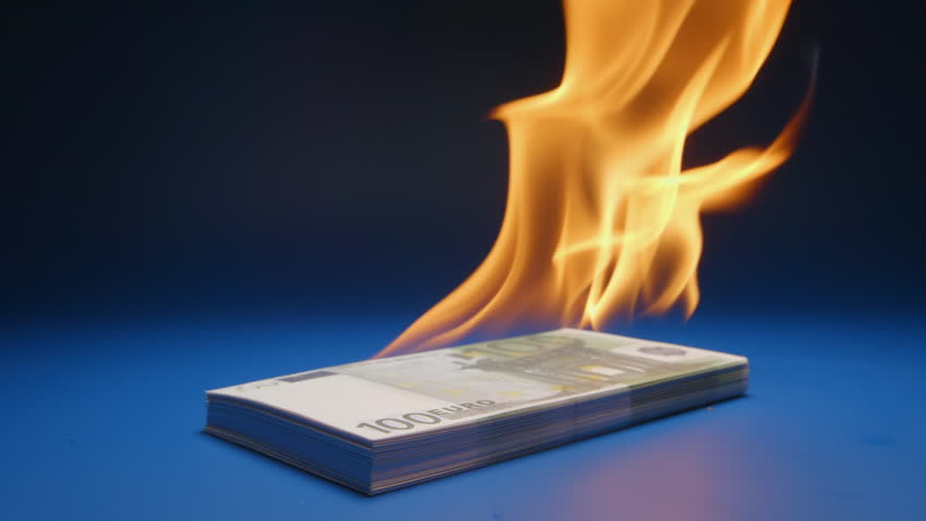 SLOW MOTION: Heap of paper money (Euro) flaming