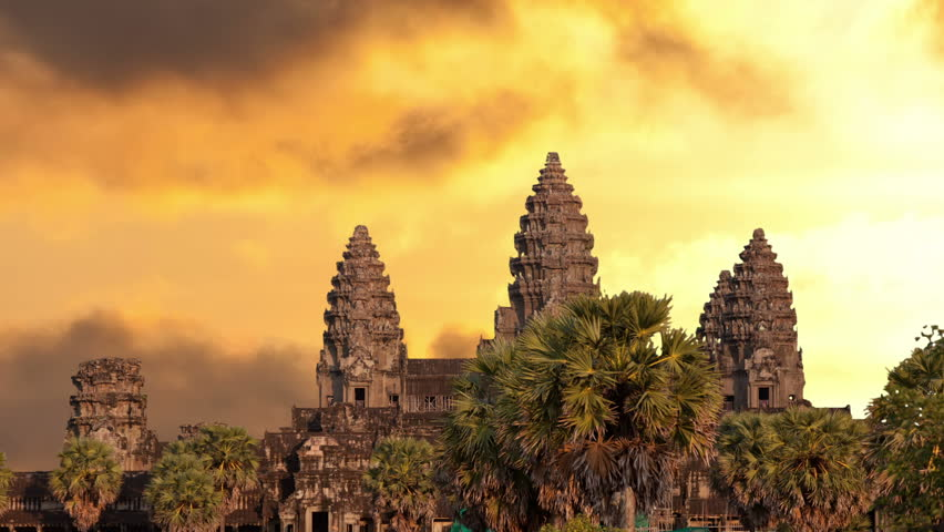 Angkor Wat temple silhouette with sunset sky and clouds