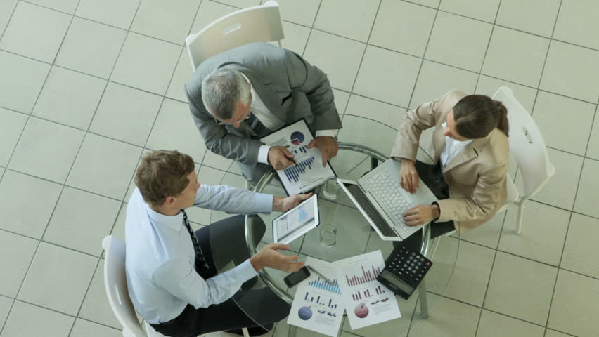 High angle view of a business group analyzing financial data