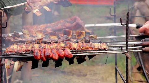 Asado, Traditional Dish in Argentina: Roasted Meat of Beef and Various other Meats, which are Cooked on a Typical Barbecue with Vertical Grills.