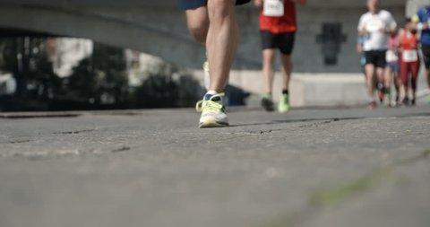GENEVA – 9 APRIL 2017 : « Courses des Ponts » Running competition in Geneva, slow motion. SOURCE: 4K 120 FPS PRORES 4444 12 BITS