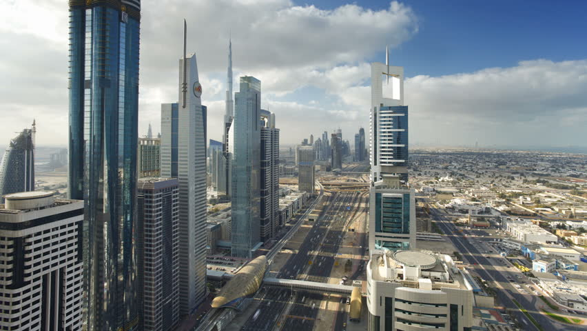 DUBAI, UNITED ARAB EMIRATES - CIRCA MAY 2011: Sheikh Zayed Rd, showing the new MTR track and station system and the Burj Khalifa in a skyline view.