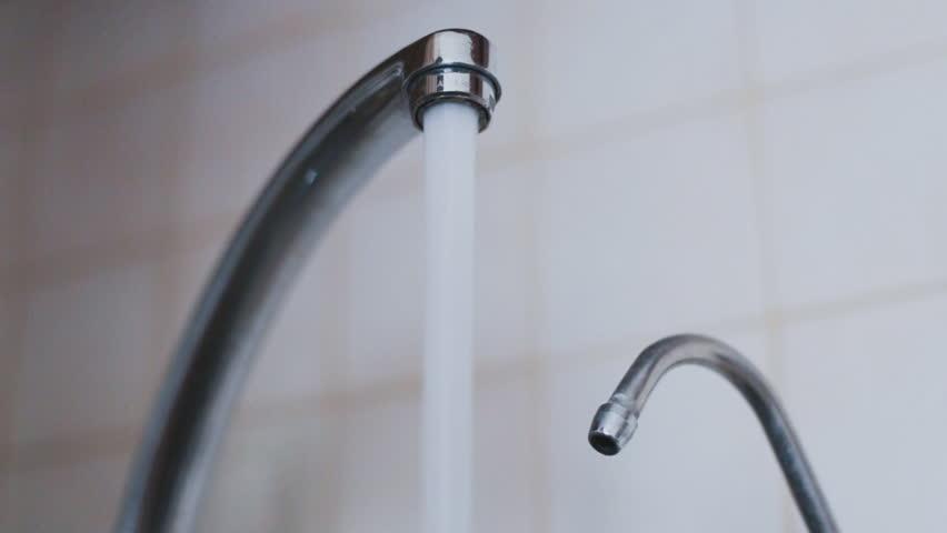 Water Faucet Running