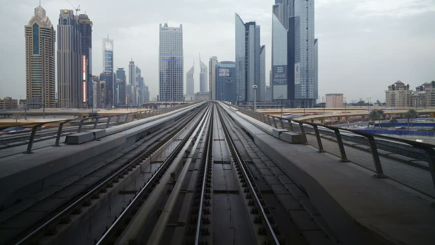 DUBAI, UNITED ARAB EMIRATES - CIRCA MAY 2011: journey on the modern driverless Dubai elevated Rail Metro System, running alongside the Sheikh Zayed Rd.