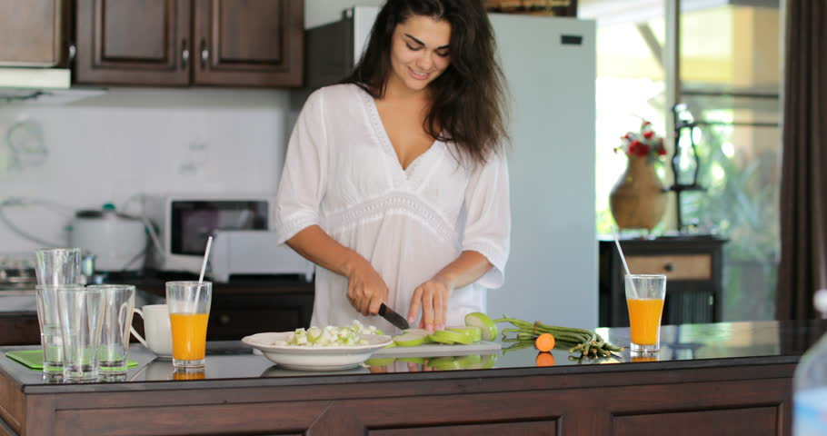 Girl Cutting Vegetables, Young Woman Happy Smiling Cooking Meal In Modern Kitchen Slow Motion 60 | Shutterstock HD Video #25960847