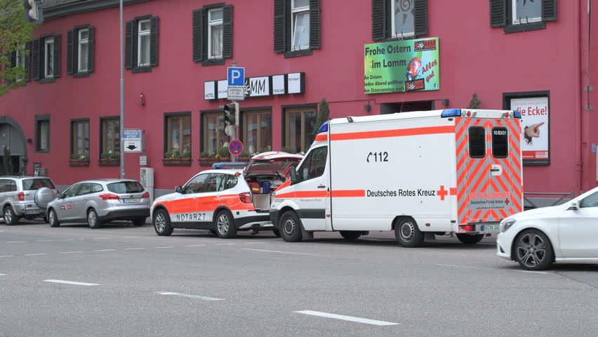 KEHL, GERMANY - CIRCA 2017: Ambulance doctor arriving fast in BMW SUV and Mercedes Ambulance van at the place of the accident at the Hauptstrase in German city of Kehl - Deutsches Rotes Kreuz