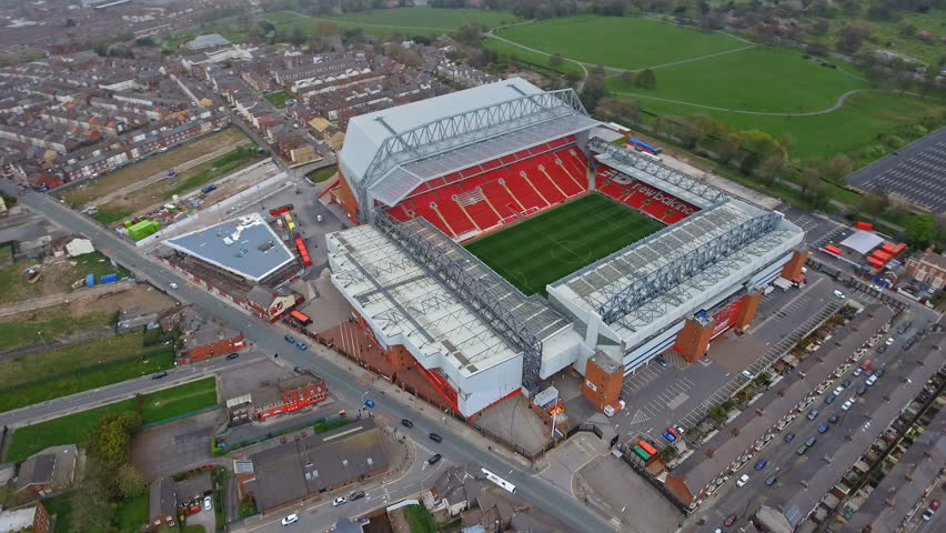 Helicopter Flight Aerial View of Anfield Stadium in Liverpool. Iconic football ground and home of one of England's most successful sides, Liverpool FC in 4K Ultra HD