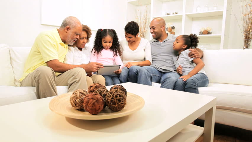 Three generations African American family using wireless tablet home