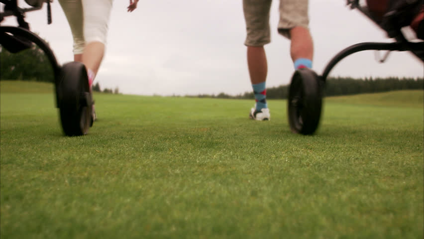 A couple walking on the golf course
