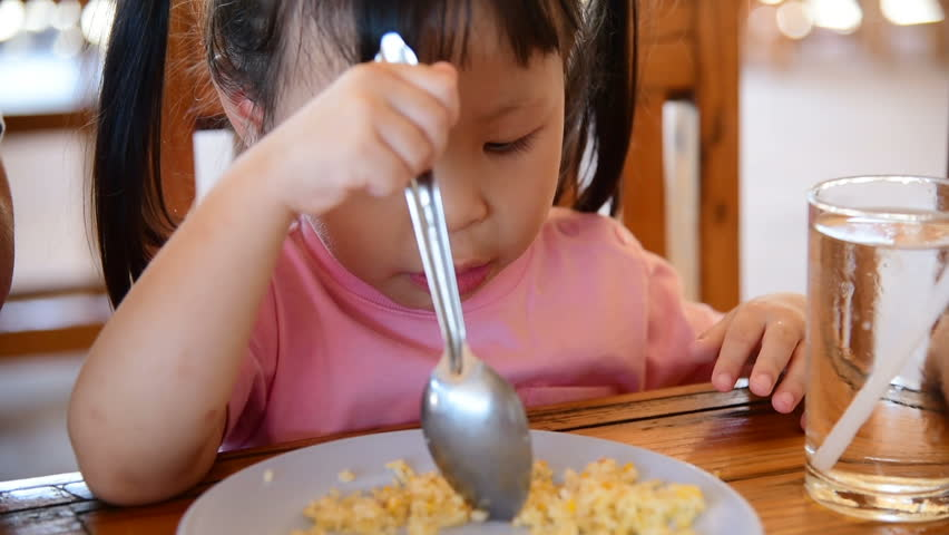 Little asian girl eating fried rice in lunch time | Shutterstock HD Video #26030417
