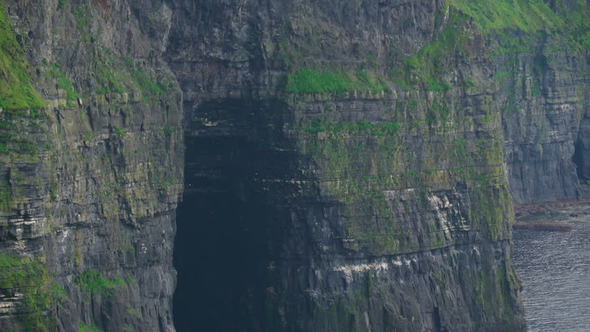The big rocks formation on the cliffs in Moher Ireland. The magnificent Cliffs of Moher top the list of places to see and things to do in Ireland and are Irelands most visited tourist attraction.