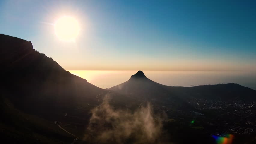 Drone reveal trough the trees on Signal hill into Cape Town city during sunrise. | Shutterstock HD Video #26081627