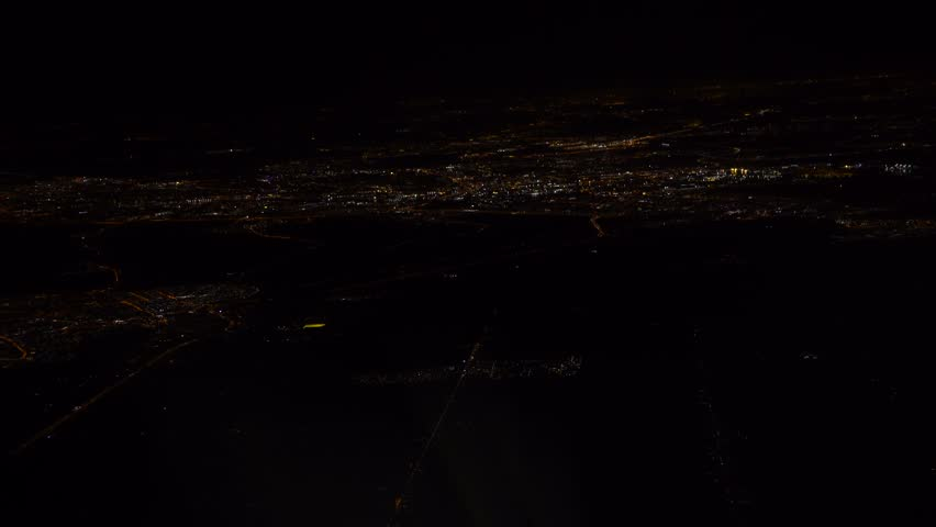 4K Lights Of Houses And Roads Amsterdam City Top View From Airplane Window At Night