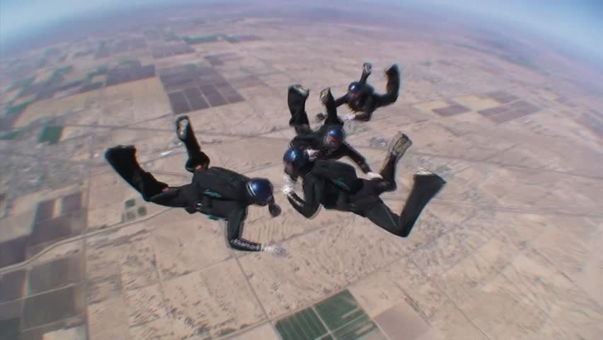 ARIZONA - CIRCA 2010: Four Skydivers Jump And Take Formation 2